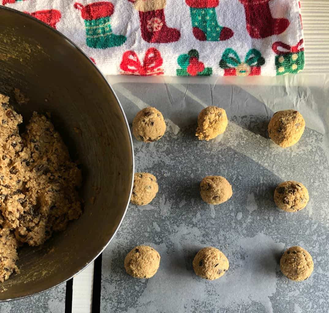 Just A Mum Oatmeal Raisin Cookies, raw dough rolled into balls.
