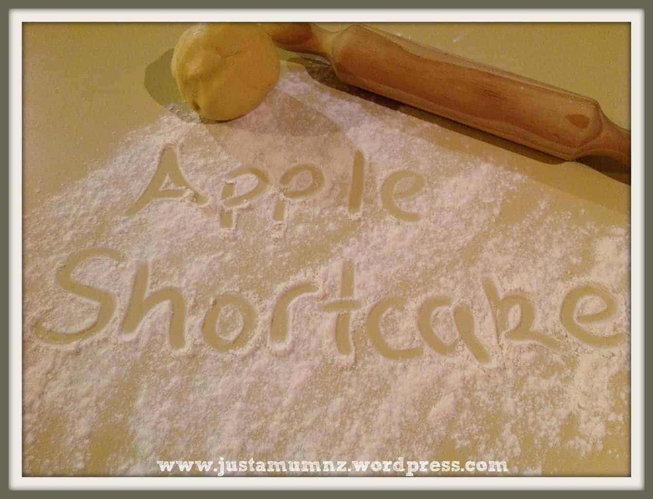 Words Apple Shortcake written in flour on the bench
