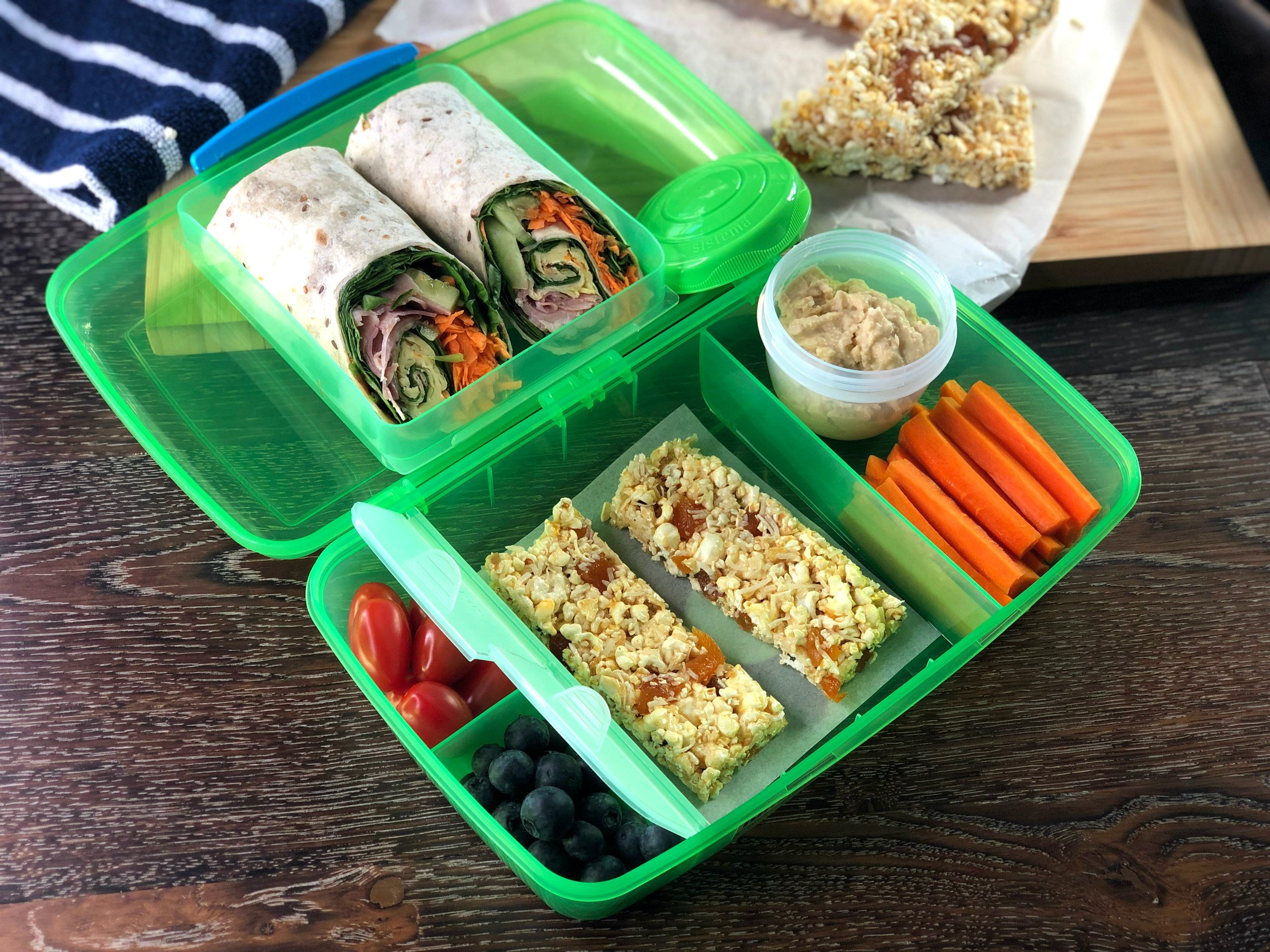 Just A Mum's Lunch Box, plastic free, nut free with Healthy Fillings, wrap, popcorn bars, vegetables and fruit