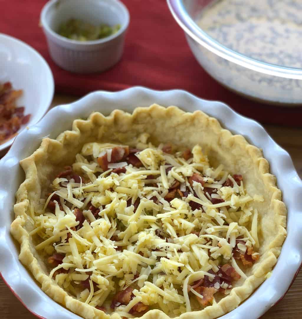 Ingredients Prepared to fill the Quiche Lorraine and crust with layers
