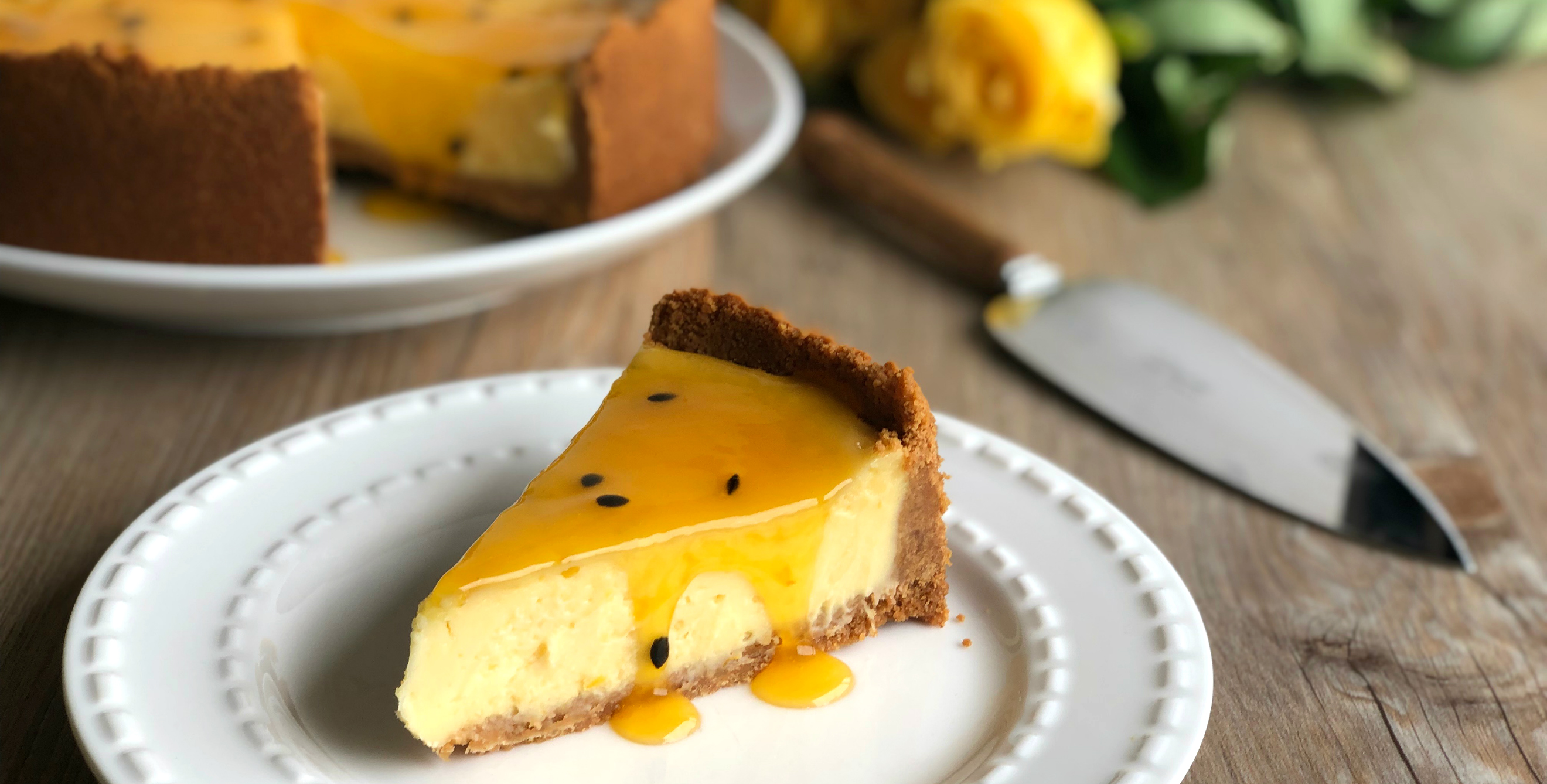 Slice of Easy Baked New York Cheesecake with Passionfruit Sauce