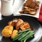 Slow Cooker Roast Pork with Garlic Honey Butter Gravy