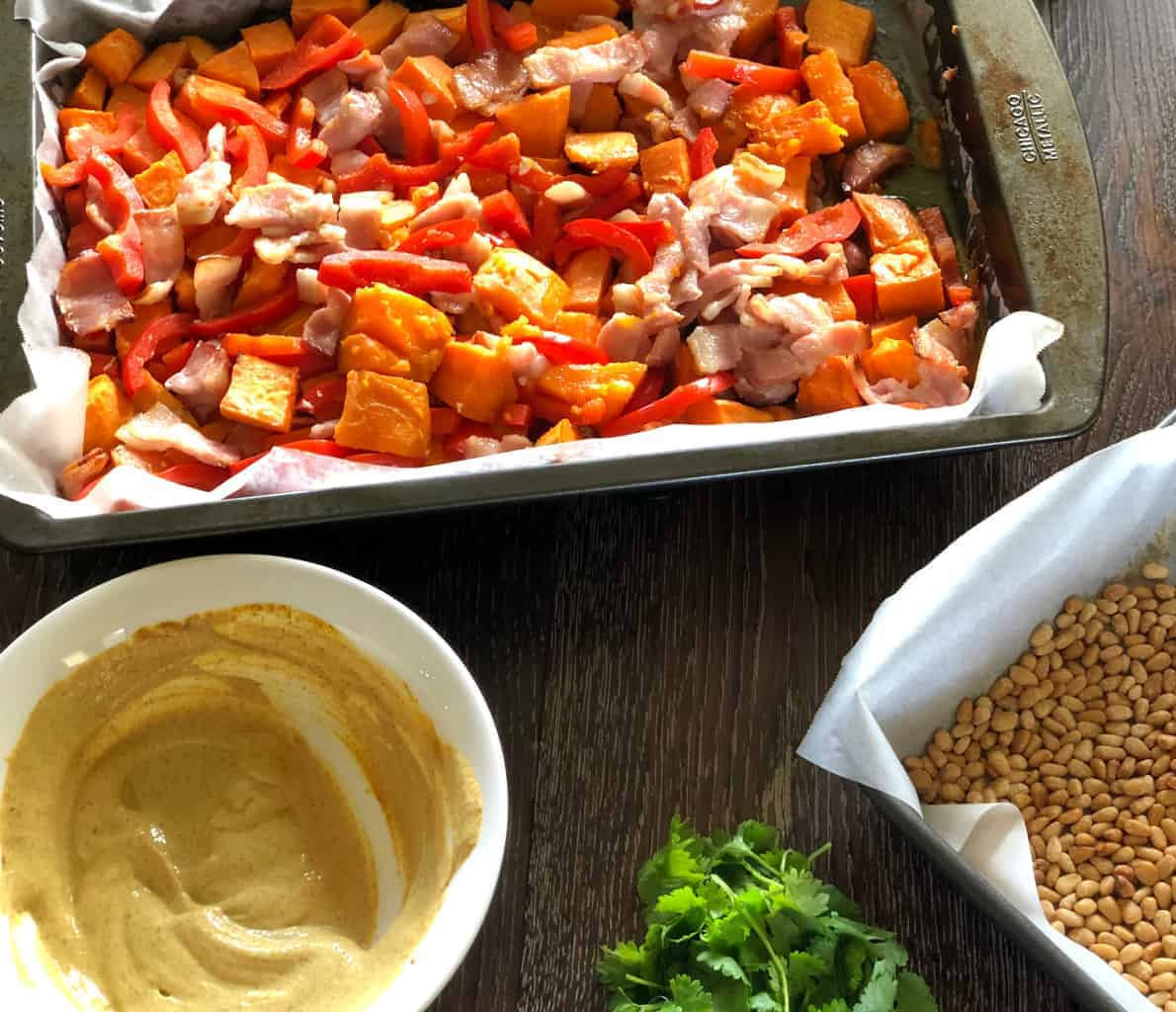 Final steps in making Kumara and Bacon Salad.