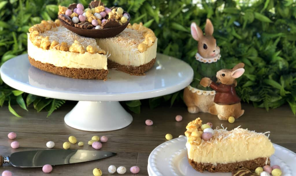 Slice of White Chocolate Coconut Cheesecake with Easter Toppings