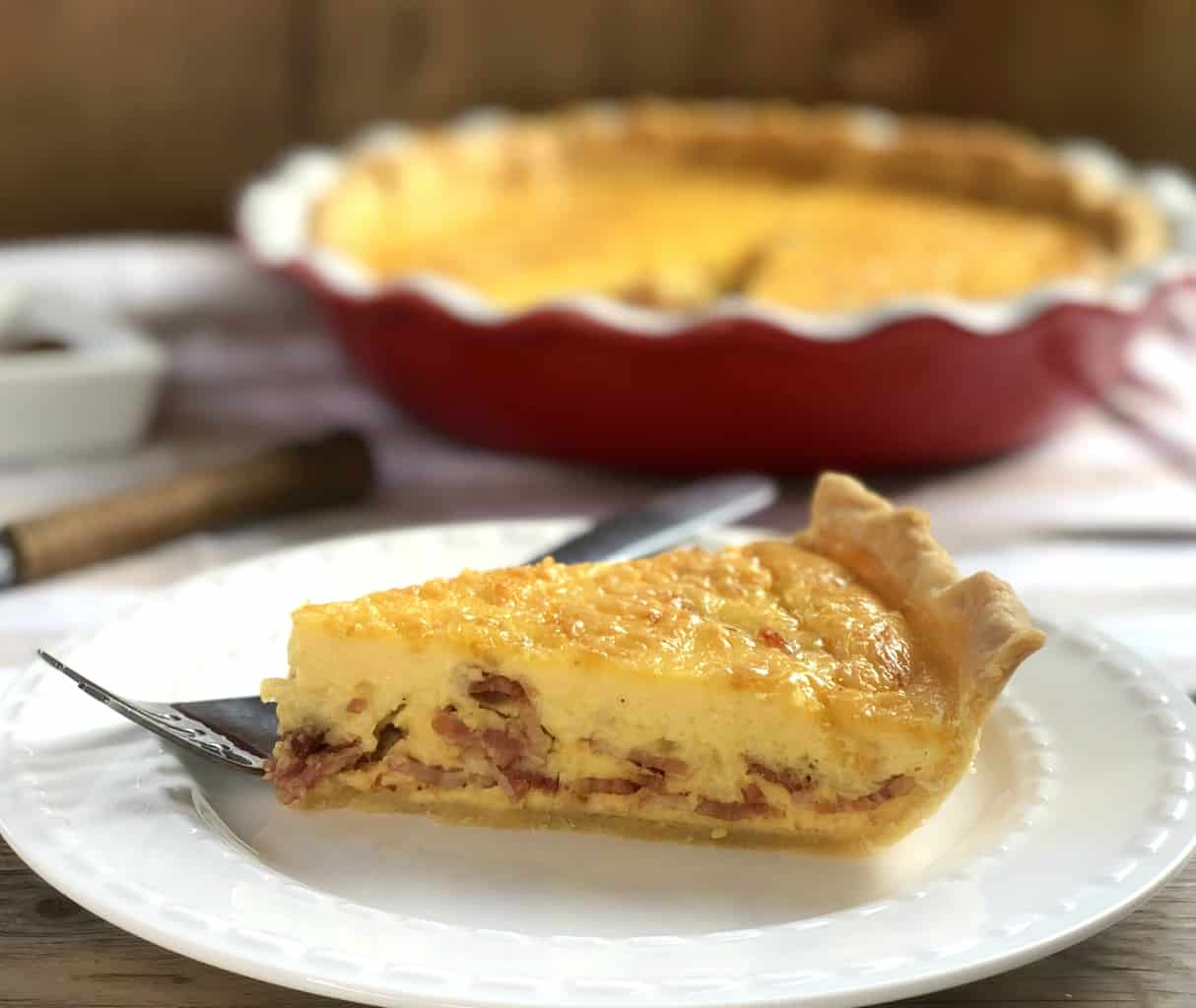 Slice of Bacon Quiche with Egg & Cheese