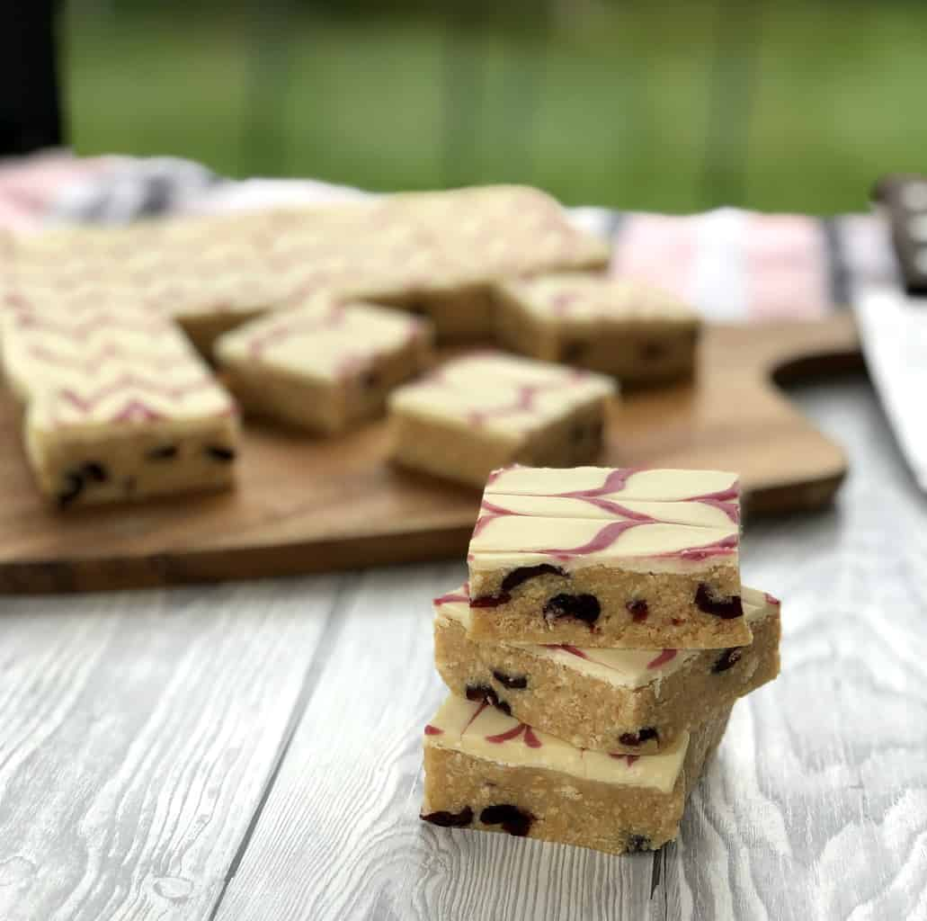 3 pieces of cranberry white chocolate no bake slice