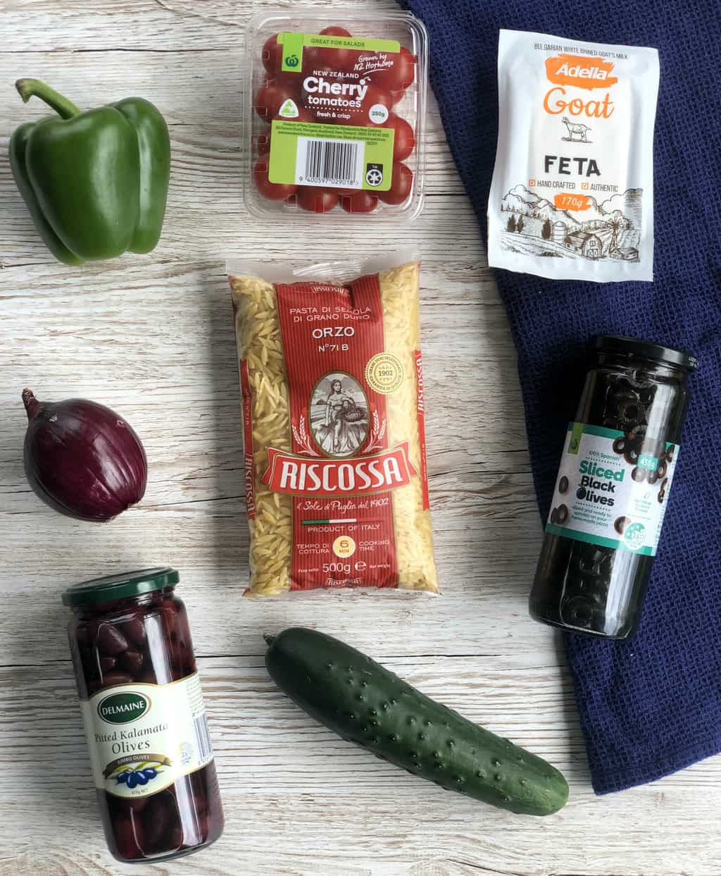 The ingredients used in a greek orzo salad, see the recipe for full details