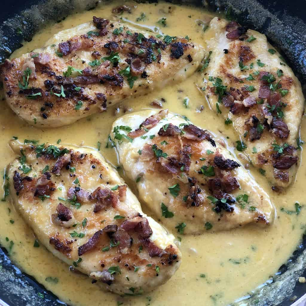 Creamy Bacon Garlic sauce with golden brown chicken breasts