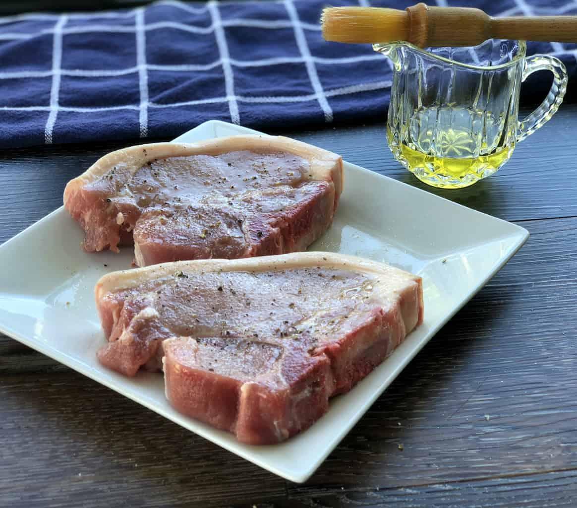 Season Pork Chops with olive oil and salt and pepper before pan frying