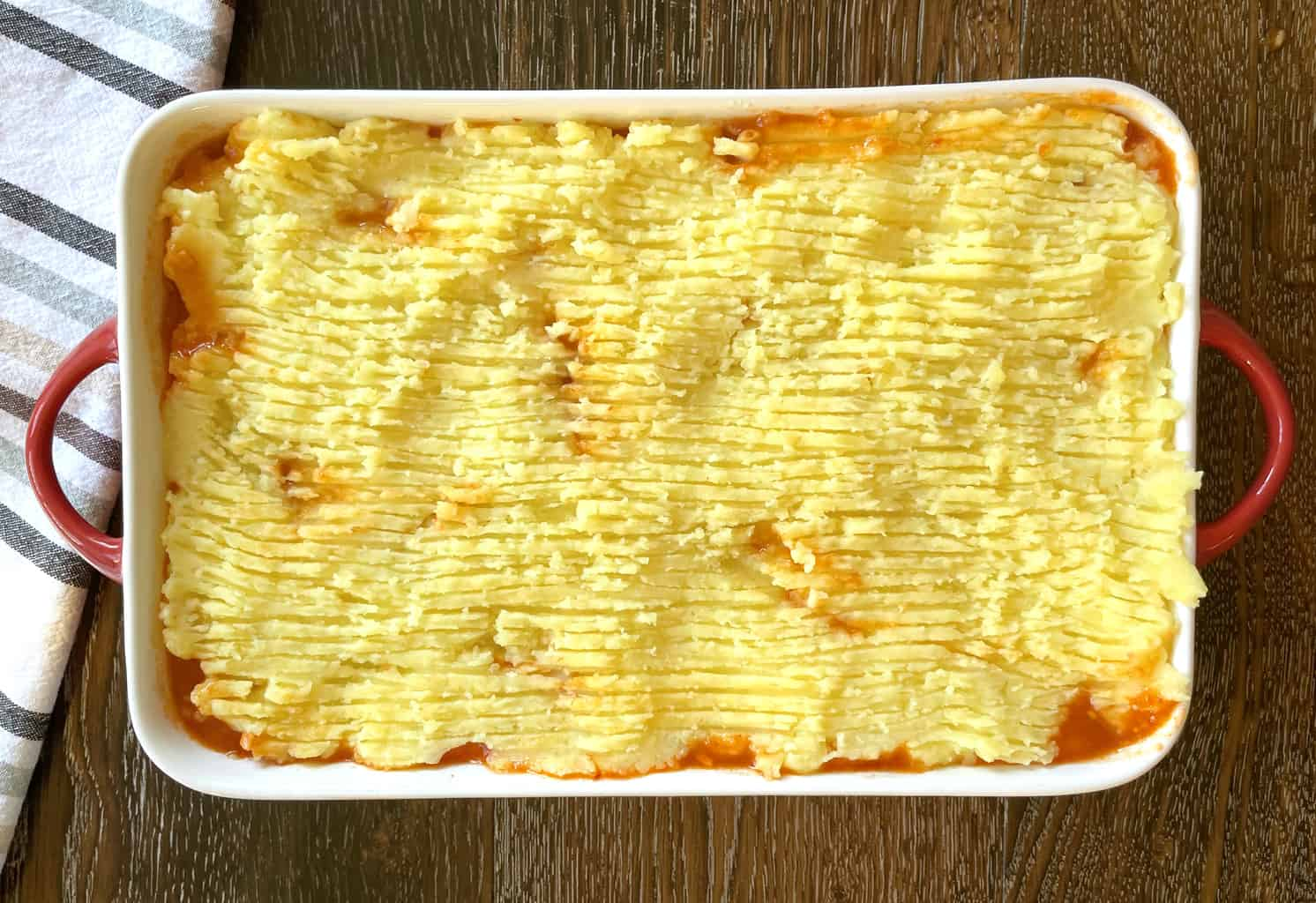 Use a fork to create lines on the shepherds pie to create a golden crust