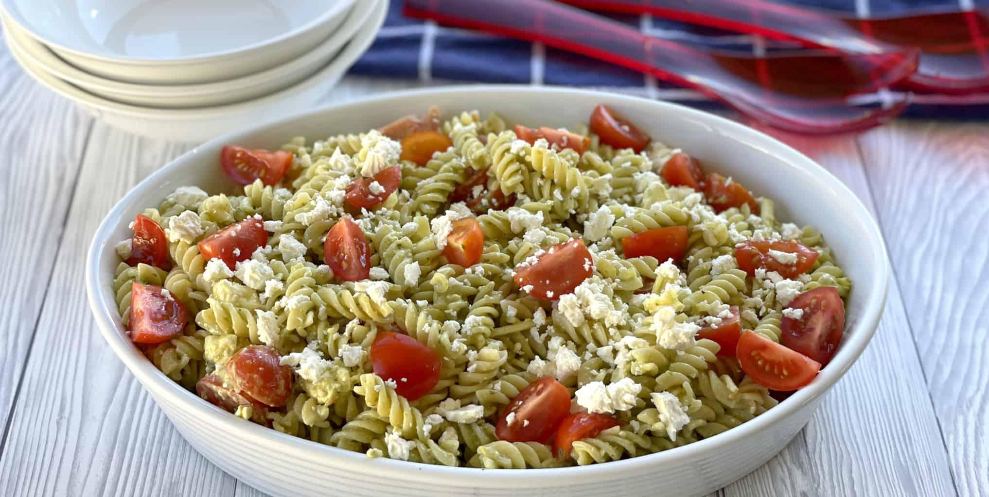 Large white bowl of Pesto Pasta Salad