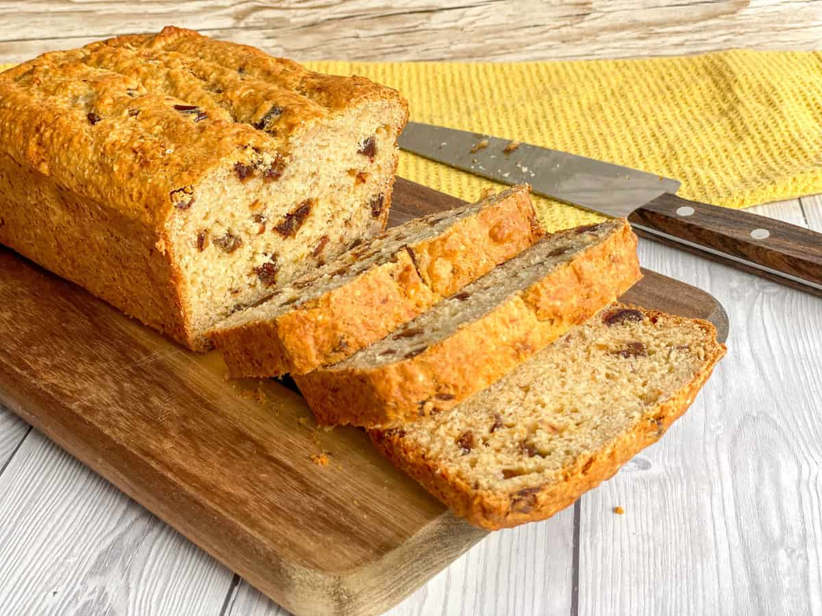 Thick Slices of banana and date loaf on a wooden chopping board