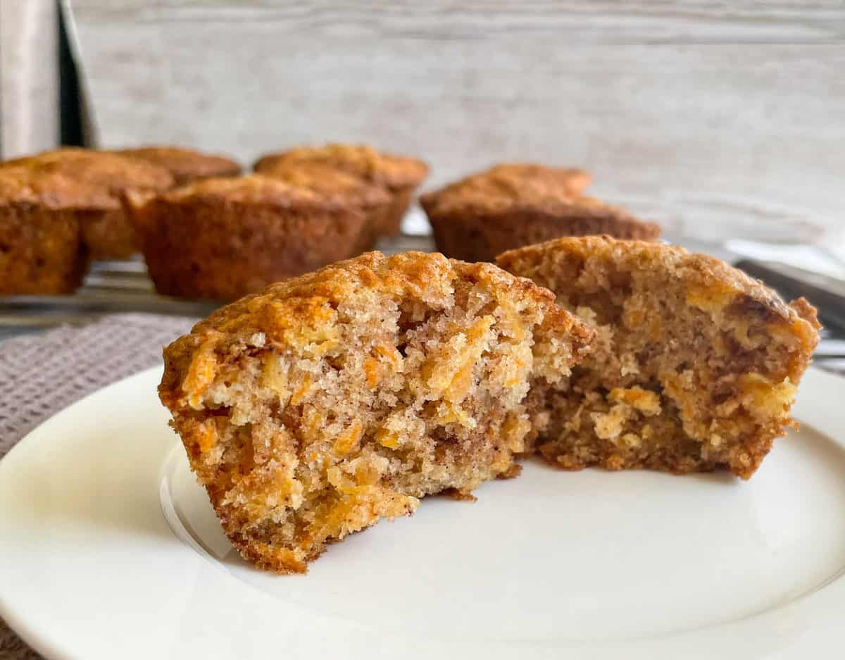 A carrot and pineapple muffin opened to reveal the soft inner part of the muffin
