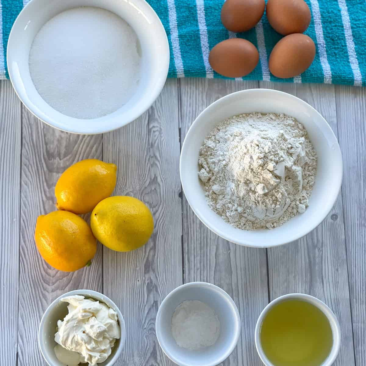 Ingredients used in making lemon syrup cake, see the recipe card for full details